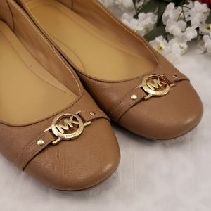 Michael Kors tan slip on loafers